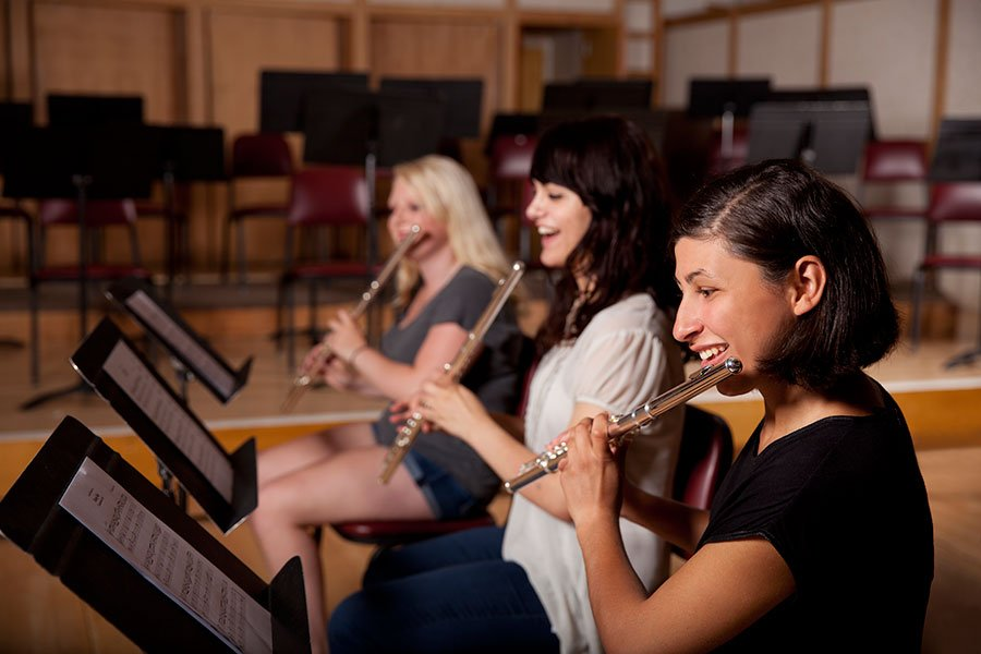 girls playing music instruments